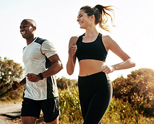 Fit, young couple running outdoors