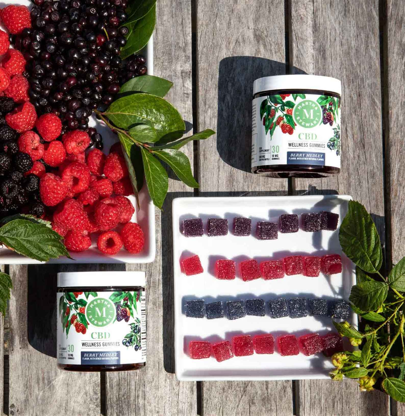 Martha Stewart CBD Wellness Berry Medley Gummies on a wooden table with berries