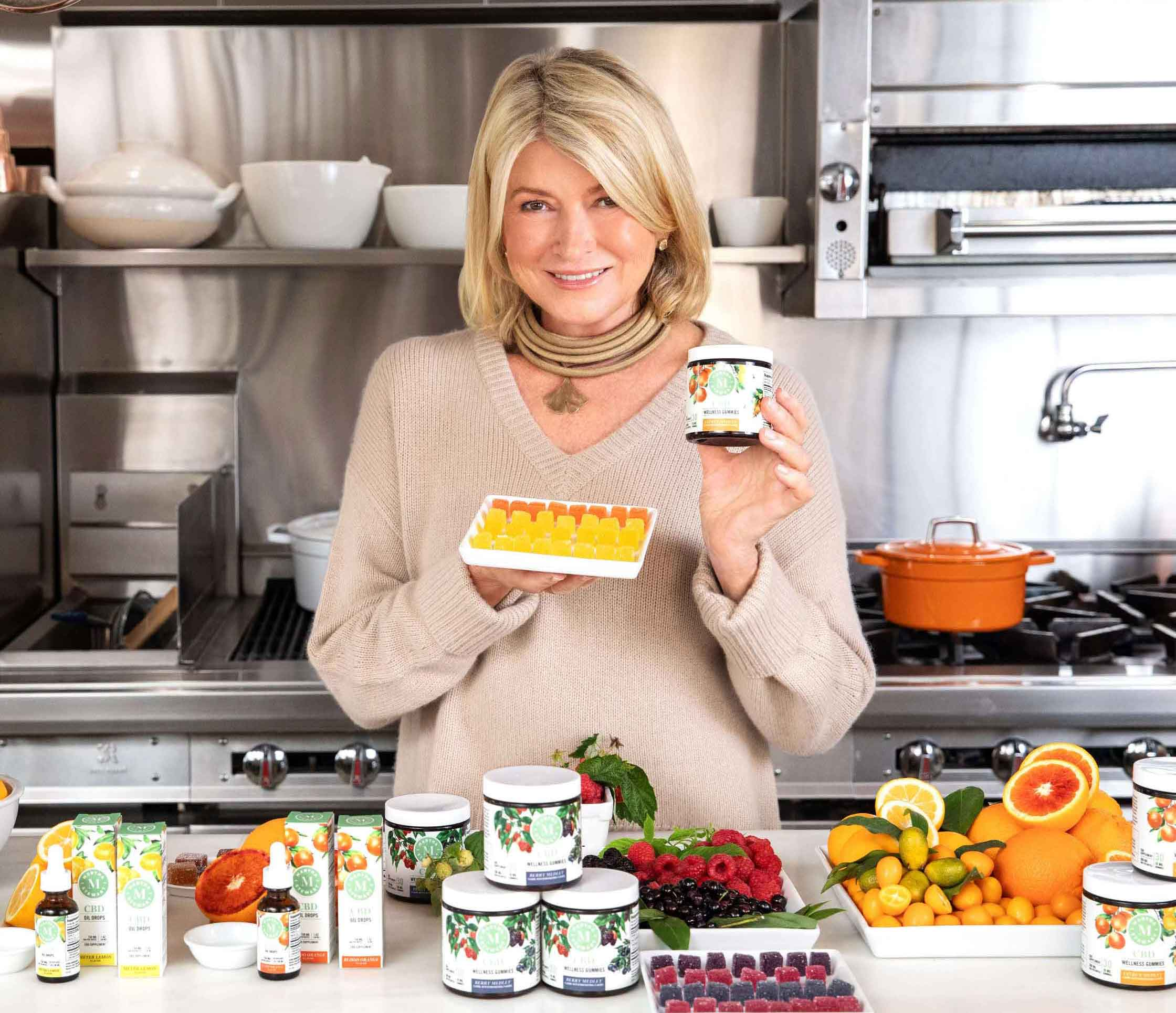 Martha Stewart holding citrus wellness CBD gummies