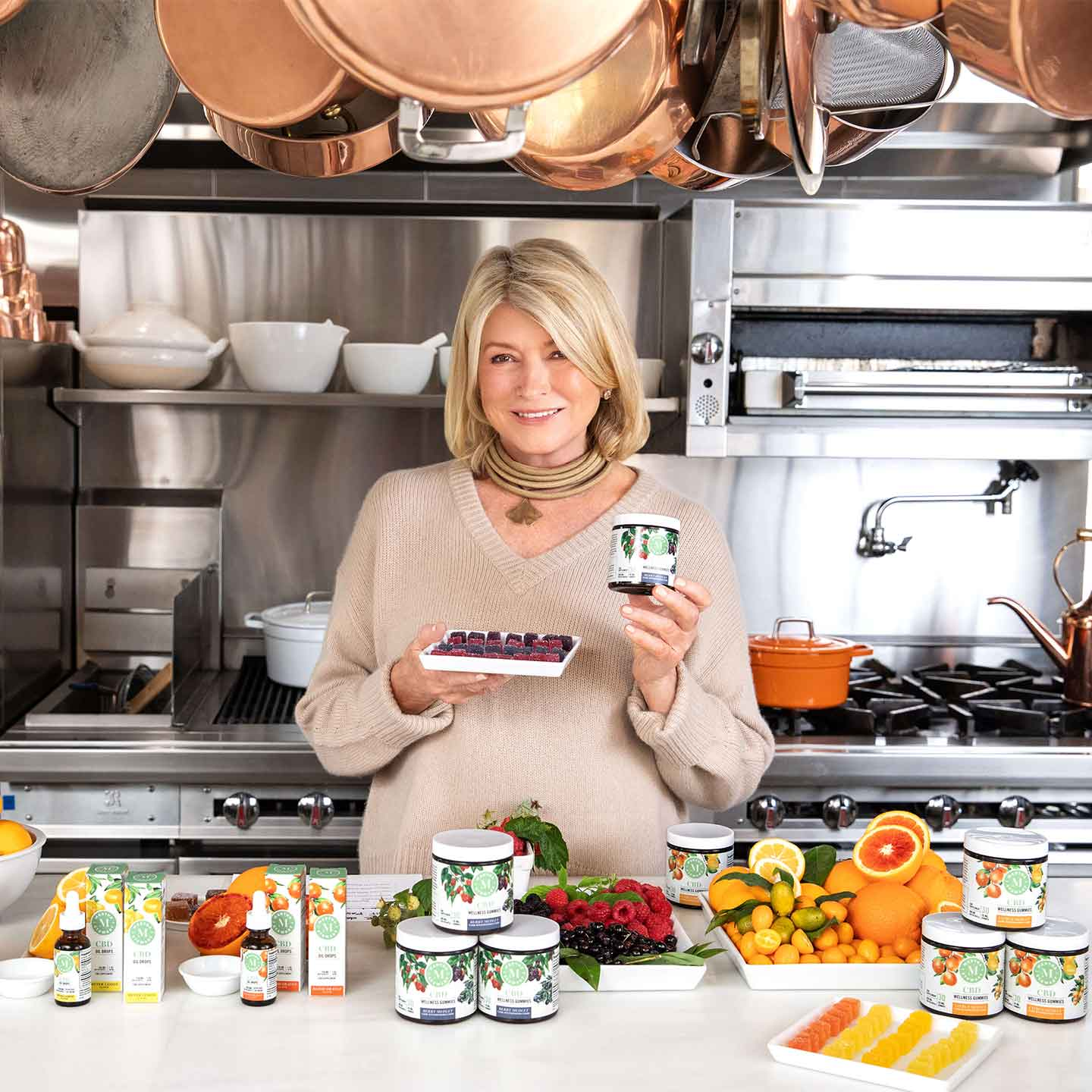 Martha Stewart holding CBD wellness gummies