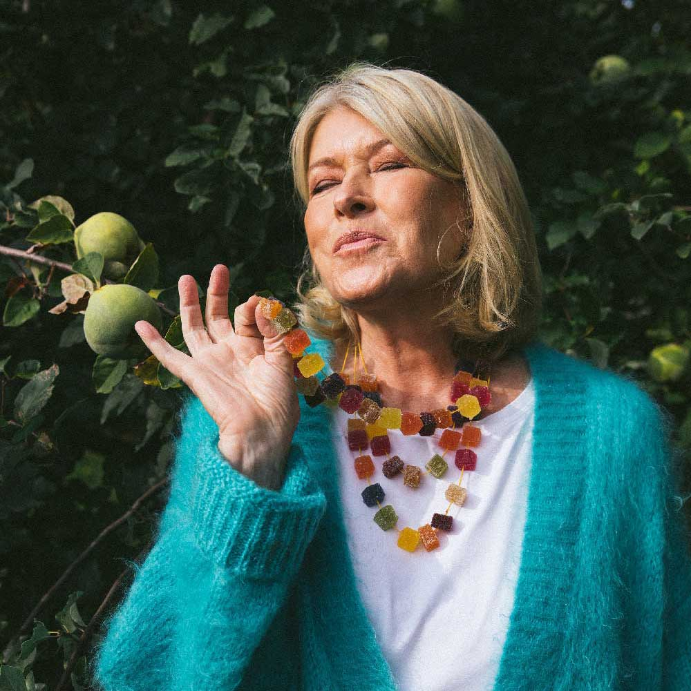 Martha Stewart wearing a necklace made of Martha Stewart CBD gummies