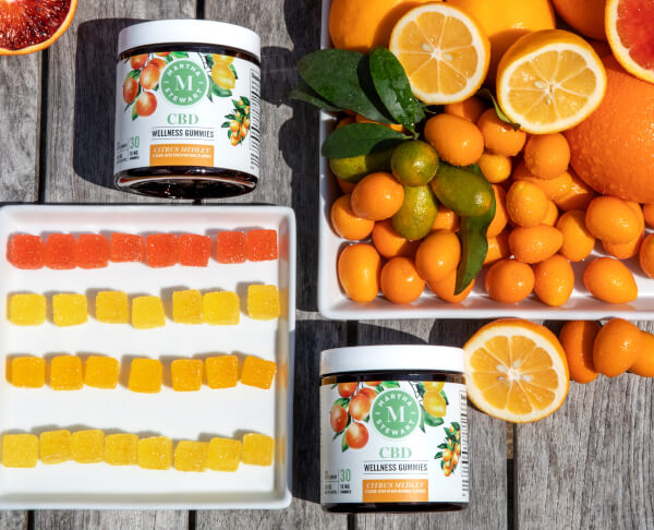 Martha Stewart CBD gummies outside with oranges and lemons