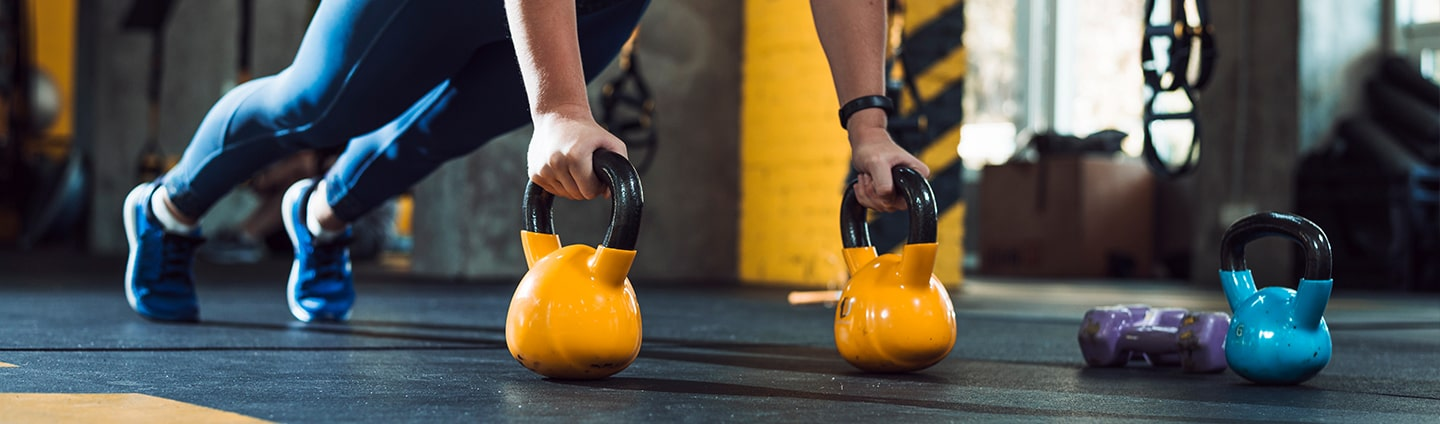 Woman working out with kettlebells